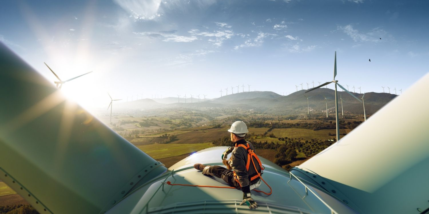 Worker at the top of a wind turbine